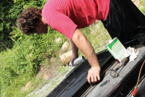 Shawn spraying rust inhibitor.