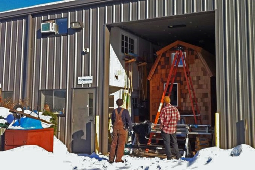 Our tiny house is safe and sound inside the builders' garage.