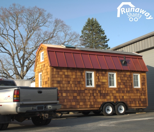 Our Runaway Shanty has finally left the garage and glows in the sunshine. The roof is almost completed.